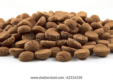 A big pile of pepernoten on a white background. - stock photo