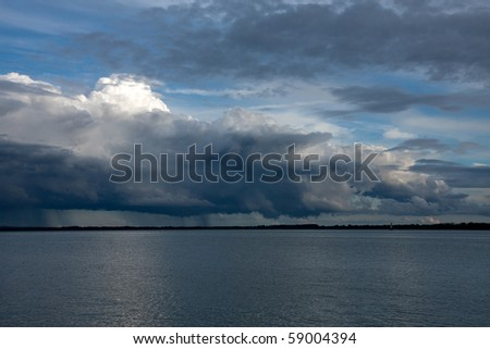 A big powerful storm clouds - stock photo