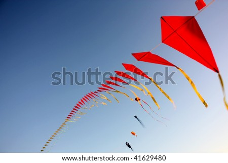 A big set of flying kites against the blue sky - stock photo