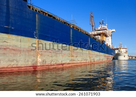 A big ship loading cargo at port of Gdansk, Poland.  - stock photo