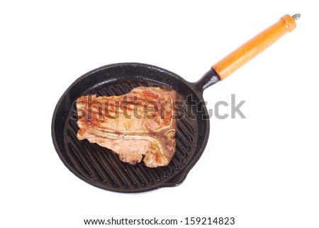 A big sirloin and rump beef steak with T-bone sizzling in a hot pan. Image isolated on white studio background. - stock photo