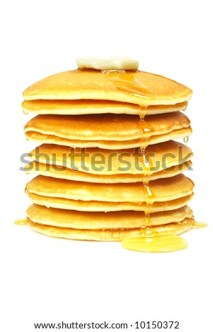 A big stack of pancakes with syrup and butter on focus. Shallow depth of field - stock photo