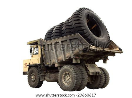 A big truck with very big wheels in the body, isolated. - stock photo