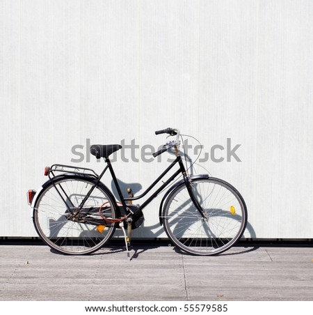 A bike leaning on a wall - stock photo