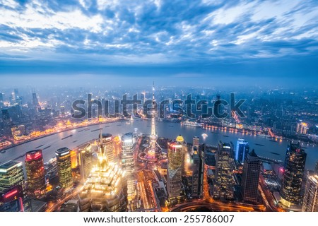 a bird's eye view of magic city of shanghai in nightfall - stock photo