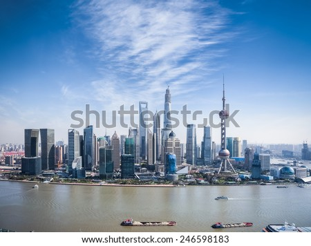 a bird's eye view of shanghai skyline with sunny sky - stock photo