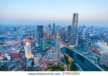 a bird's eye view of tianjin at dusk , China - stock photo