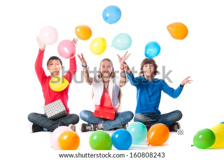 a birthday girl with her two friends with presents and balloons on a white background - stock photo