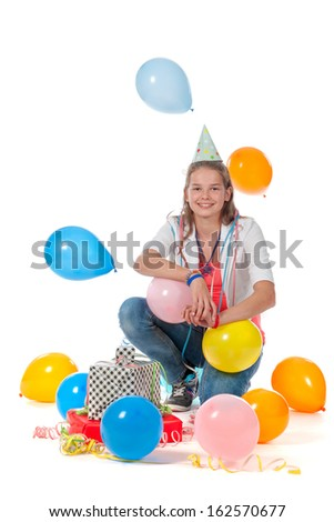 a birthday girl with presents and balloons on a white background - stock photo
