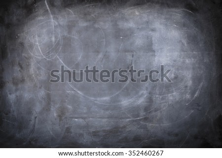 A black and white background of a chalkboard with texture. - stock photo