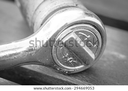 A black and white close-up of a ratchet tool - stock photo
