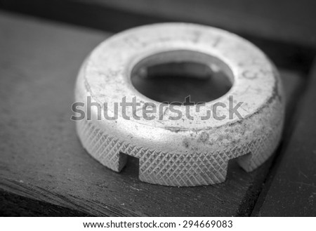 A black and white image of a bicycle spoke key tool with numbers showing the different sizes - stock photo