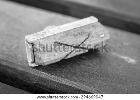 A black and white image of a worn bicycle brake pad - stock photo