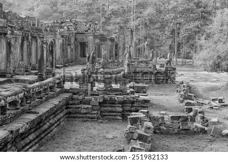 a black and white image of ancient Khmer ruins in Cambodia - stock photo