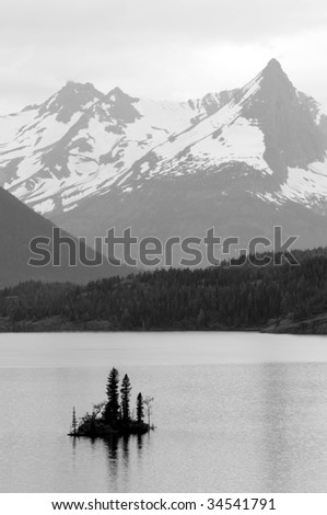 A black and white photo of the Wild Goose Island and Saint Mary Lake in the Glacier National Park in Montana, northwestern USA, shot in early July. - stock photo