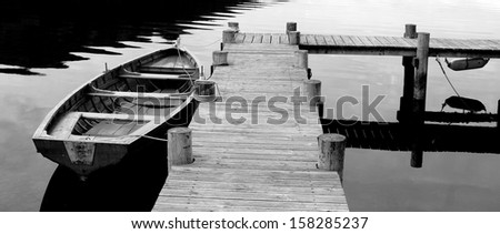 A Black and White shot of Row Boat - stock photo