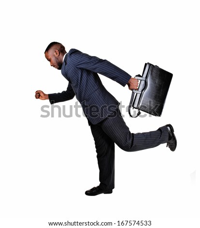 A black business man with his briefcase is running for white background in a blue suit.  - stock photo