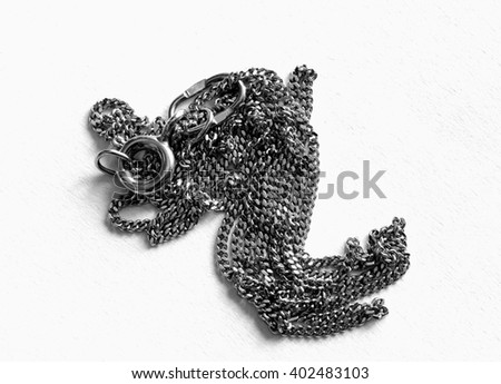 A black chain isolated against a white background - stock photo
