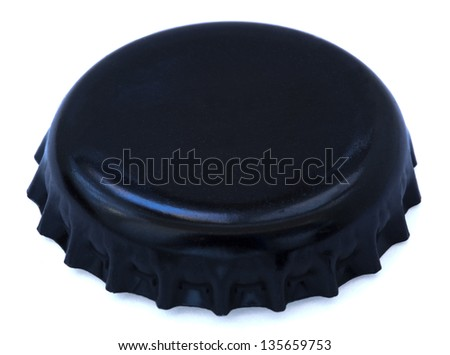 A black colored metal cap, used for glass soda bottles. Isolated on white background. - stock photo