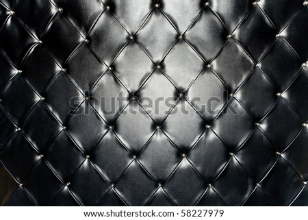 A black genuine leather upholstery - stock photo
