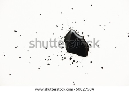 a black ink drops on white - stock photo