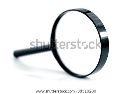A black magnifying glass over white.  Very shallow DOF. - stock photo