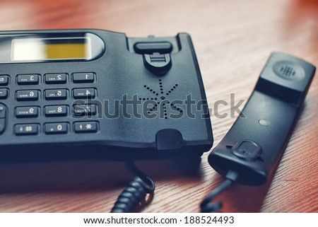 A black office receiver wtith a cord - stock photo