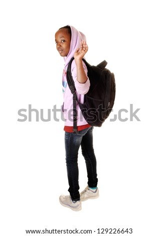 A black teen school girl waving goodbye and leaving for school with her black backpack on her back for white background. - stock photo