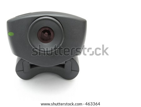 A black USB Internet Webcam with red lens and green led light - stock photo