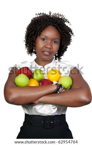 A black woman holding an assortment of fruit - stock photo