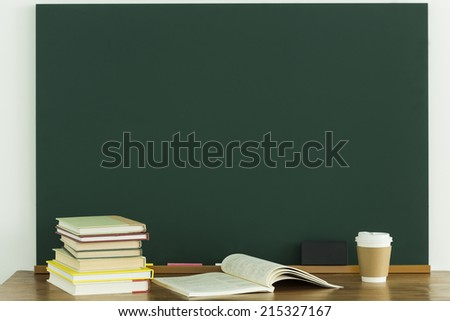 A blackboard and book - stock photo