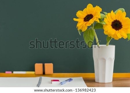 A blackboard and sunflower - stock photo