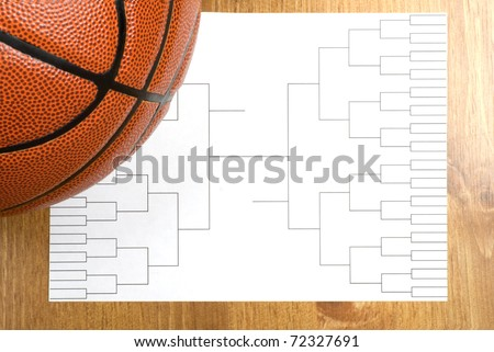 A blank basketball tournament bracket and a basketball - stock photo
