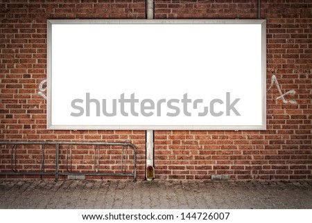 A blank billboard in a run down part of town for your advertising needs. - stock photo