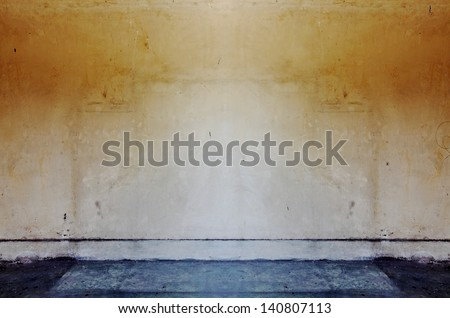 A blank grungy brown dilapidated mason wall with copyspace for text.  - stock photo