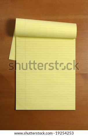 A blank legal pad on an office desk - stock photo