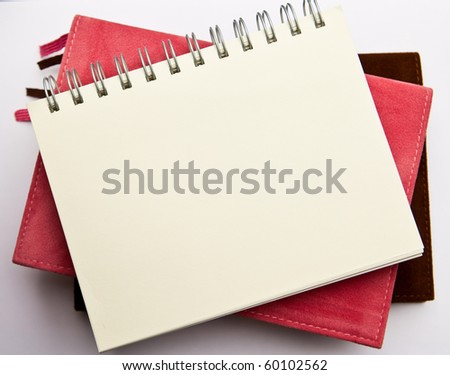 A blank note pad. - stock photo