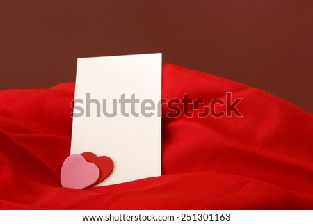 A blank notecard placed within a romantic scene. - stock photo
