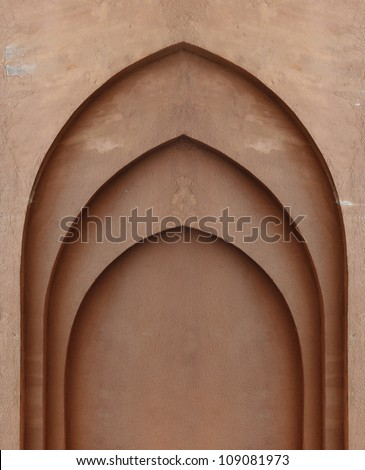 A blank religious altar on a grungy brown clay wall. - stock photo