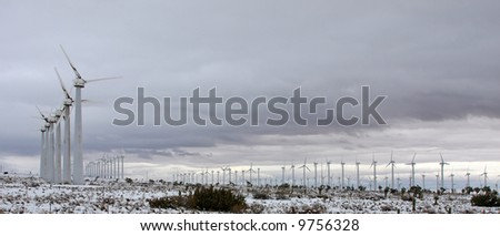 A blanket of snow around the Tehachapi Wind Farm and surrounding areas after a powerful winter storm. The Tehachapi Wind Farm in southern California's Kern county - stock photo