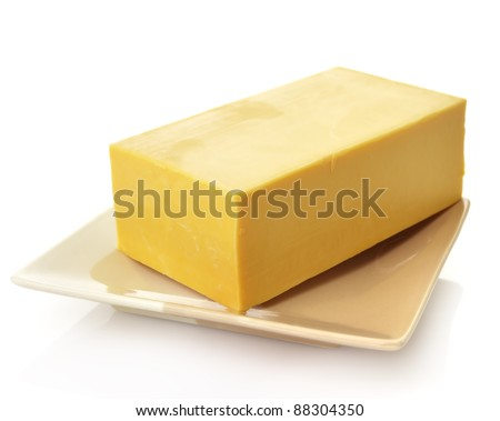 A block of Cheddar Cheese In A Dish - stock photo
