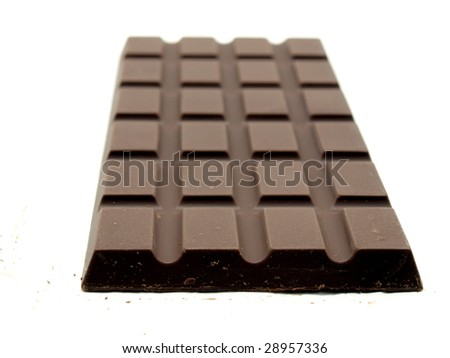 A block of dark chocolate isolated on white background. - stock photo