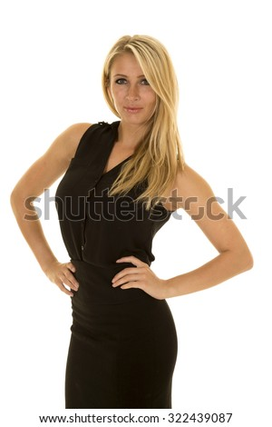 A blond business woman in her black dress with a small smile on her lips, and a determined expression on her face. - stock photo