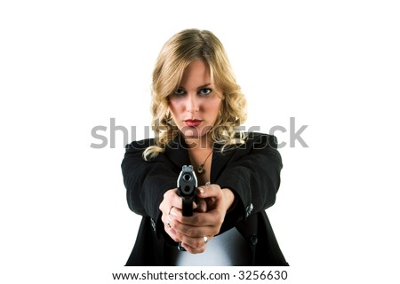A blond girl in a suit with a handgun - stock photo