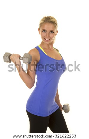 A blond woman working out with her weights, doing arms curls. - stock photo