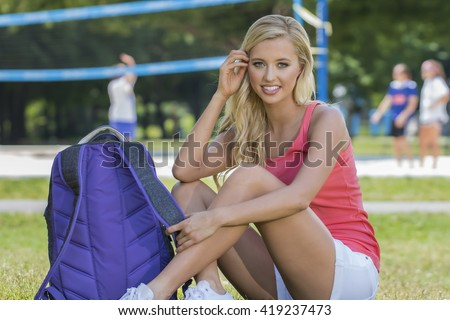 A blonde coed model posing in an outdoor environment - stock photo