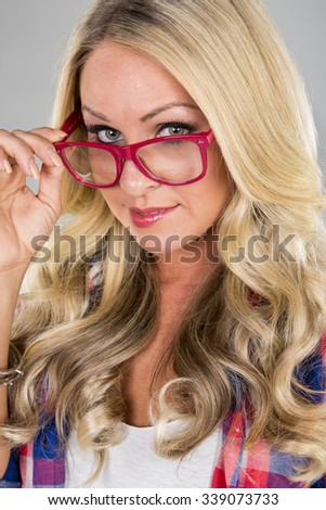 A blonde model posing in a studio environment - stock photo