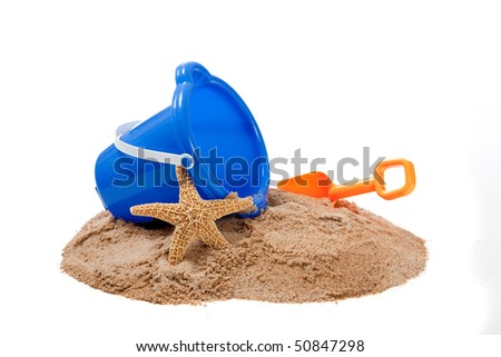 A blue Bucket and and orange shovel on the beach with a starfish - stock photo