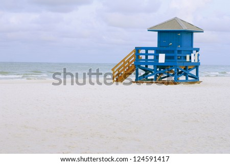 A blue lifeguard hut on an empty morning beach - stock photo