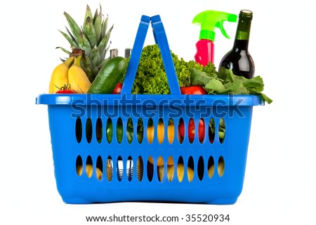 A blue plastic shopping basket on a white background filled with groceries, flat view - stock photo